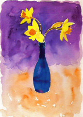 daffodils in blue bottle